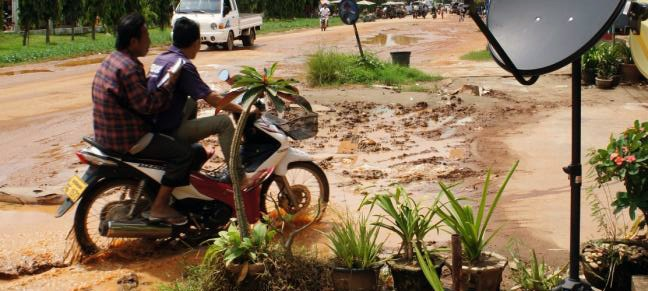 Jeremy in Lao - flooded road near market