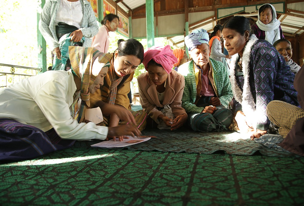 Some of the community training participants at Pulin Village, with MIID Project and Research Coordinator, Hla Myo Thwe.